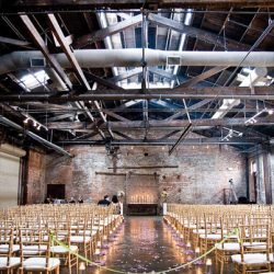Rows of gold Chiavari wedding chairs at an Atlanta venue - The Rented Event
