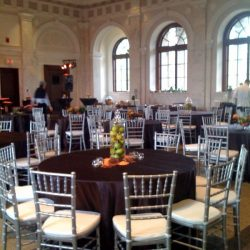 Reception decorated with black table clothes and silver Chiavari chairs - The Rented Event