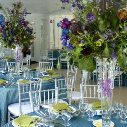 Wedding reception with teal colors and silver Chiavari chairs - The Rented Event