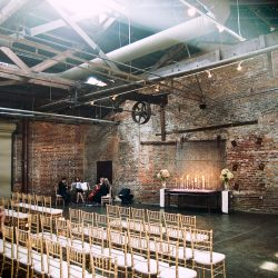 Gold Chiavari chairs at a wedding venue - The Rented Event