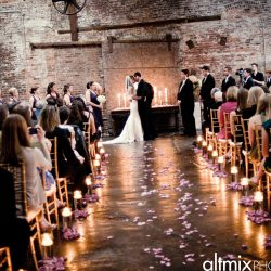 The first kiss at a wedding with guests sitting on Chiavari chairs - The Rented Event