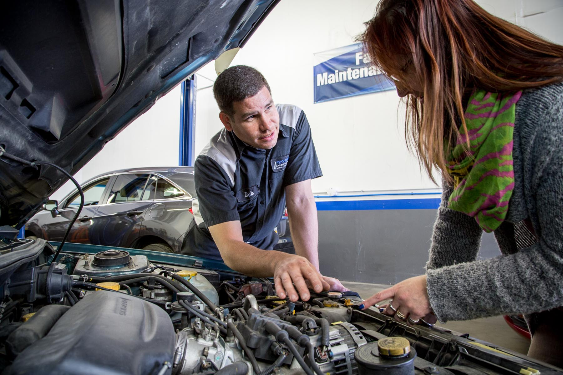 Mechanic Discussing Car Repairs