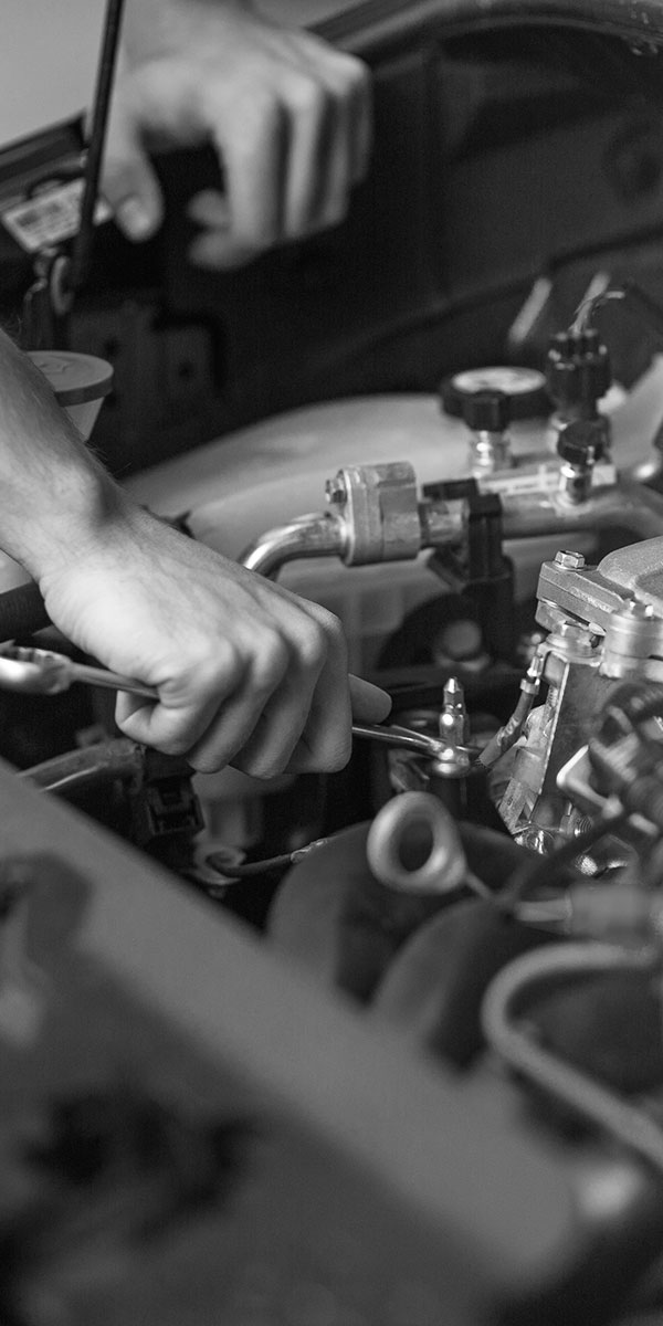 Mechanic Using Wrench on Engine Part