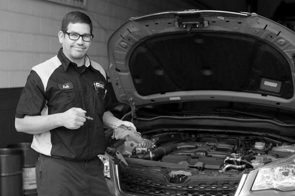 Mechanic Inspecting Fluid Levels
