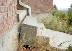 These concrete steps have suffered from severe settling over time and have separated from the foundation structure.