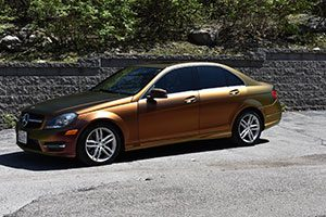 A brown sedan with windows tinted by Tint Rite.