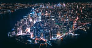 Aerial view of New York City lit up at night.