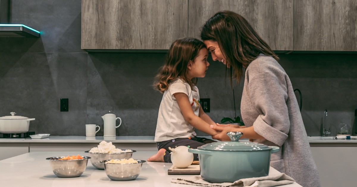 Mother and daughter cooking a plant-based meal together.