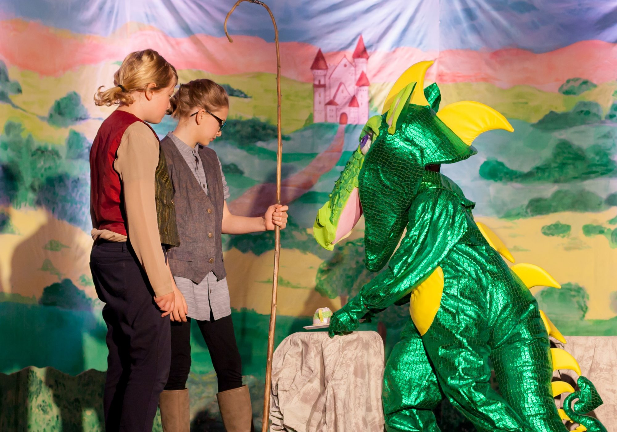 Students on stage for a play.