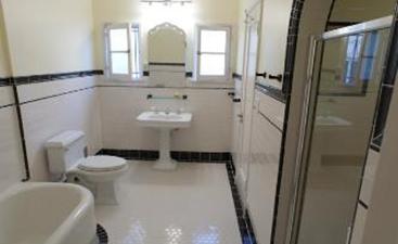Bathroom remodel using porcelain tile.