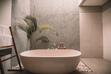 An image of a bathroom, looking directly at the bathtub.