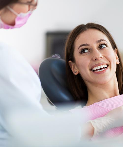 Happy Woman in Dentist Chair