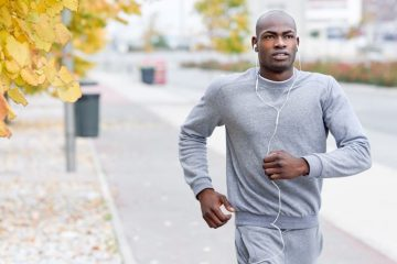 man running in the fall, listening to music