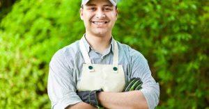 A gardener with a white linen apron.