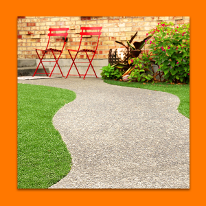 A gravel path cuts through a lawn to a pair of red folding chairs.