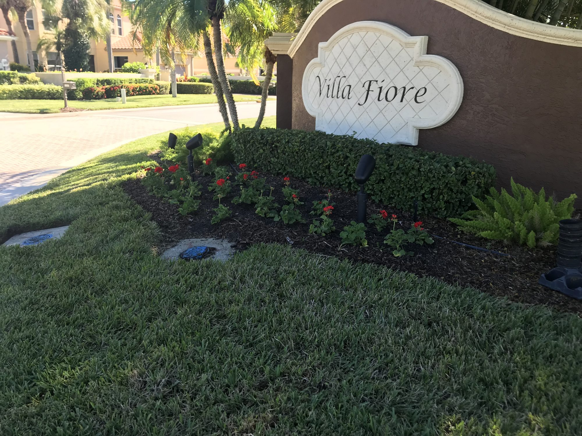 "A neatly landscaped entrance to the neighborhood ""Villa Fiore"""