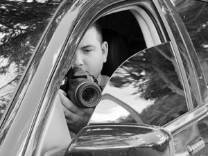Private Investigator in Car with Camera