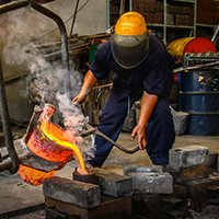 Worker Pouring Hot Molds