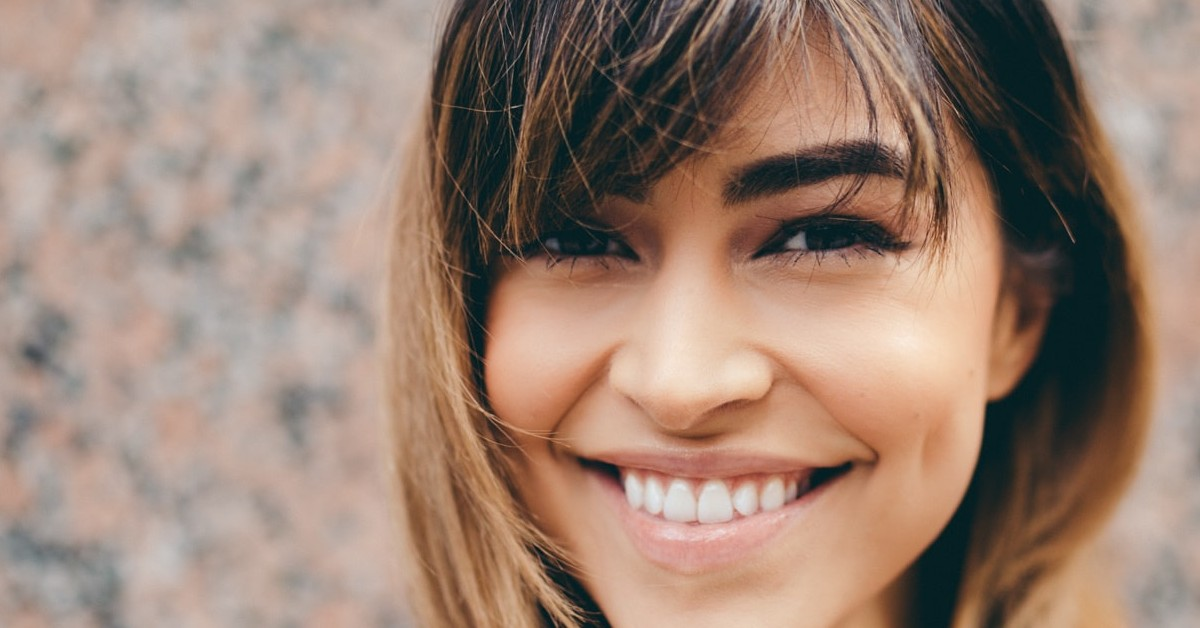 latina woman with white teeth smiling