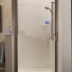 A picture of a shower with a swinging door.