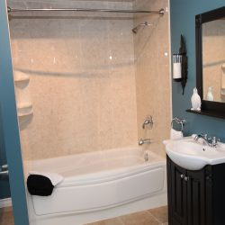 A picture of a nice bathtub/shower combo, installed by Upscale Bath Solutions.