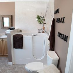 A picture of a nice, modern bathroom with an accessible jet tub, remodeled by Upscale Bath Solutions.