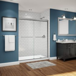 A picture of a gorgeous blue bathroom with a shower, remodeled by Upscale Bath Solutions.