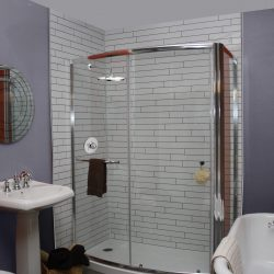 A picturew of a gorgeous bathroom with a shower with tile walls, remodeled by Upscale Bath Solutions.