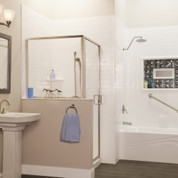 A picture of a sleek bathroom with a tub/shower combo that features a swinging door.