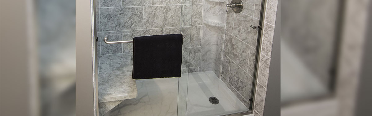 clear shower door with black towel