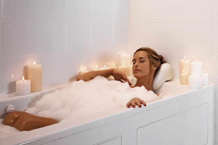 woman taking bath with candles