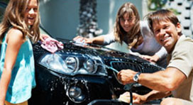 Family Cleaning a Sports Car