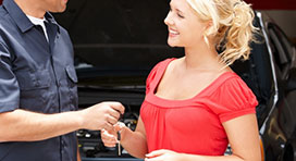 Mechanic Handing Keys to a Client