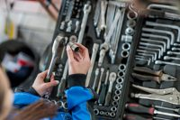 Mechanic Using Socket Wrench