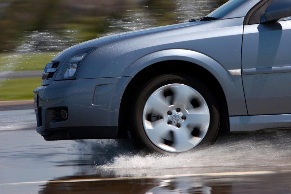 Car Braking on Rainy Road