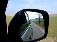 Sideview Mirror of Open Road
