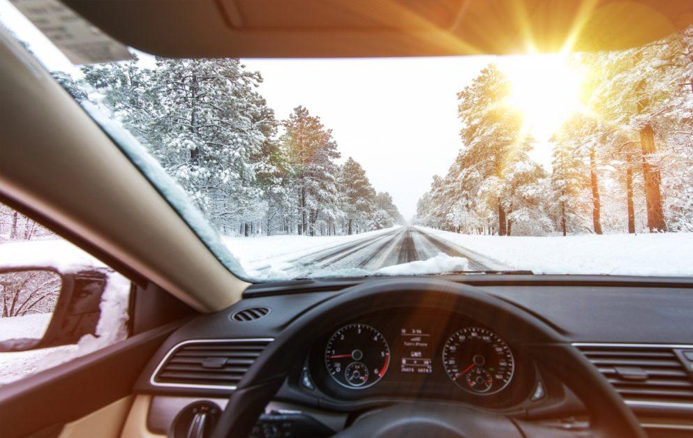 Car Interior on Winter Road
