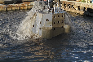 A U.S. Aqua service made dredge is removed from the water.