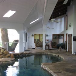 A sunroom and indoor pool by remodeling company Vanguard North in Tallahassee.