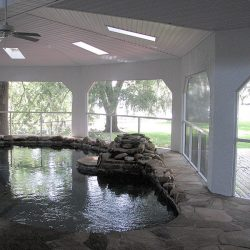 An indoor pool in a sunroom addition by Vanguard North in Tallahassee.