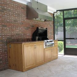 An outdoor kitchen by home remodeling company Vanguard North in Tallahassee.