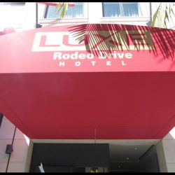 Entrance awning with custom awning graphics for Luxe Hotel