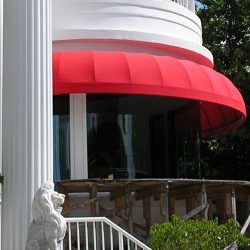 Red awning fabric on a residential awning