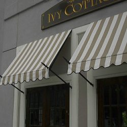 Commercial spearhead awnings for Ivy Cottages with striped awning fabric
