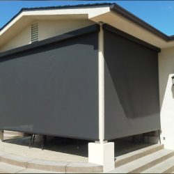 Dark drop-roll awning shades for a porch