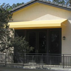 Yellow awning fabric on a residential porch awning