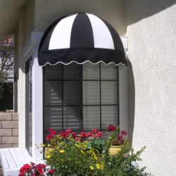 Window dome awning with black and white awning fabric