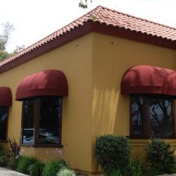 Residential dome awnings with red awning fabric