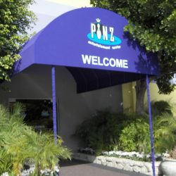 Purple entrance awning with custom awning graphics for Pinz