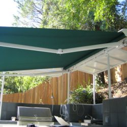 Green awning fabric on a residential retractable awning
